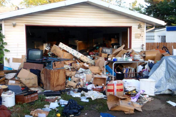 garage full to the brim with rubbish