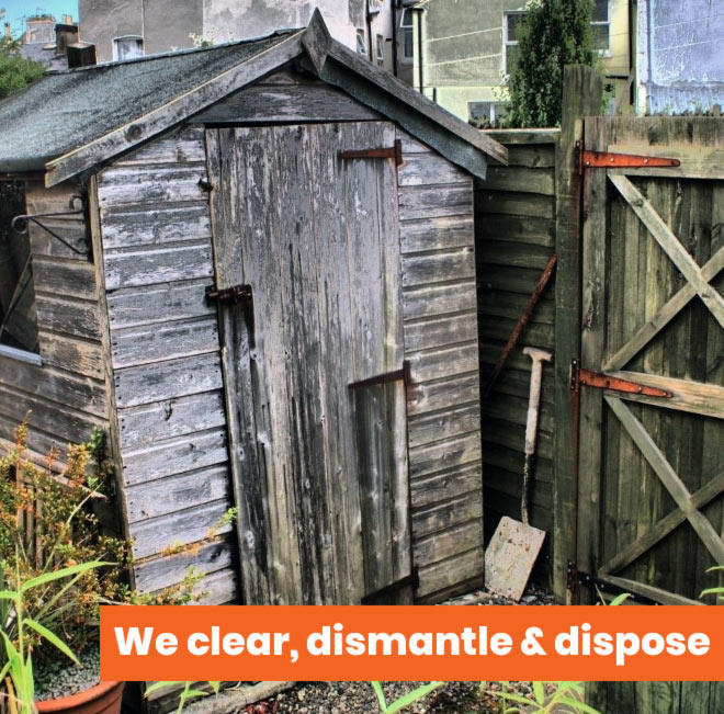 old shed with message we clear dismantle and dispose